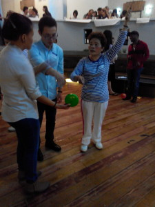Learning the Chinese yoyo with local elders (plus storytelling)