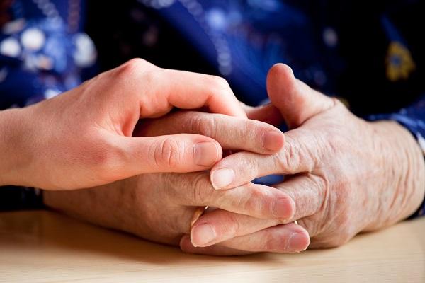 caregiver with elderly hands
